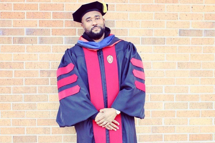 Troy M Williams in academic regalia for PhD graduation, spring 2021 - Crop