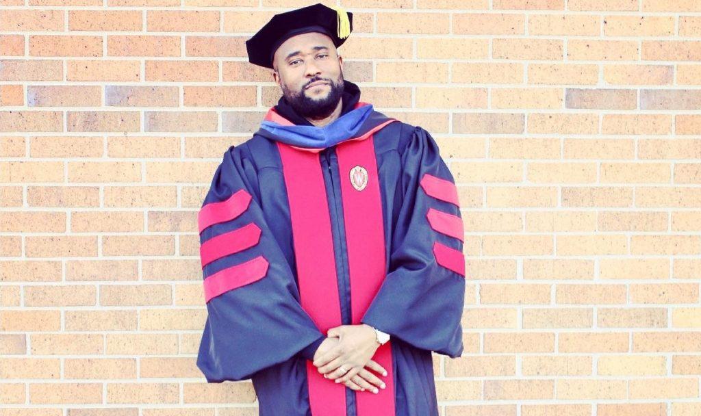 Troy M Williams in academic regalia for PhD graduation, spring 2021