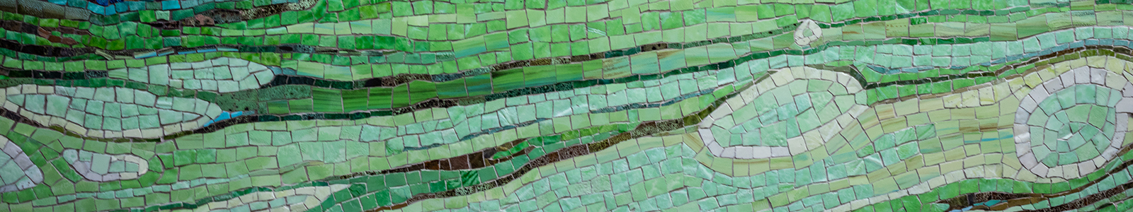A closeup of 'Threshold' a green, tile mosaic created by Lynn Basa, located in the main entrance to Nancy Nicholas Hall.