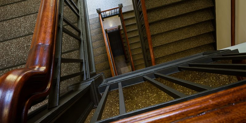 Looking down several flights of winding stairs at Nancy Nicholas Hall.