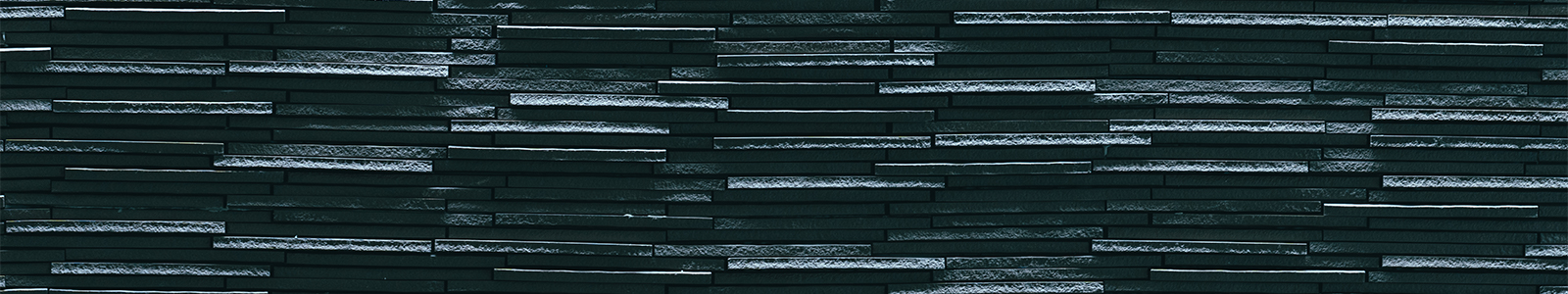 Texture of gray tile on a wall in Nancy Nicholas Hall