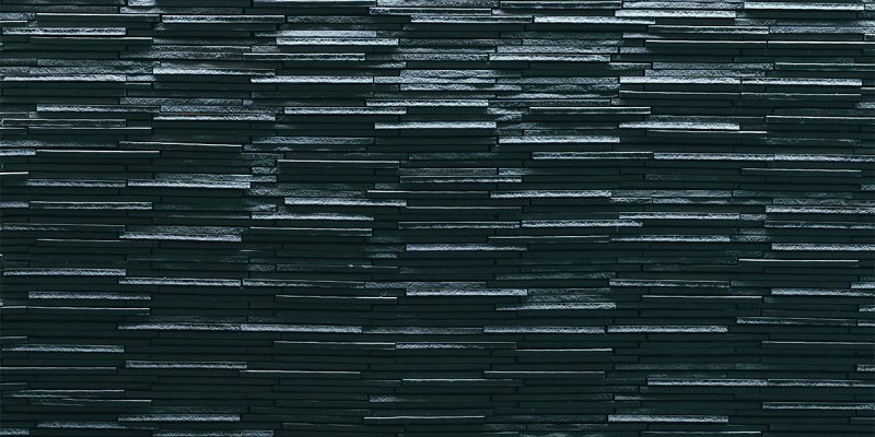 Texture of gray tile from the wall in Nancy Nicholas Hall.