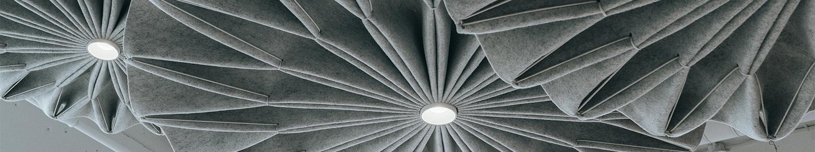 Closeup of three, gray, felt pinwheel lamps in the Dorothy O'Brien Innovation Lab.